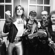 SAXON - L-R:: Pete Gill, Bif Byford, Paul Quinn, Steve Dawson, Graham Oliver - backstage at the Odeon Hammersmith in London UK - 26 Nov 1979.  Photo credit: George Bodnar Archive/IconicPix